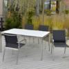 Edelstahl-Terrassentisch Manhattan mit HPL-Tischplatte und Gartenstuhl Barcelona |WALLI Gartenmöbel