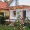 Terrassendach in Lärchenholz mit Glas-Eindeckung und Textil-Beschattung